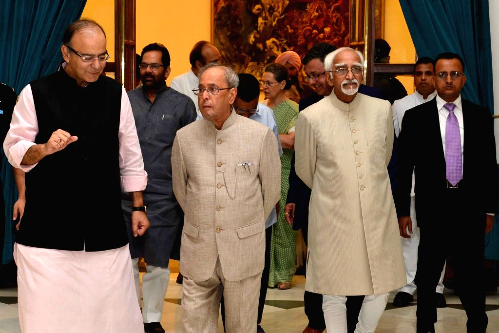 President Pranab Mukherjee and Vice-President Mohammad Hamid Ansari with ​Union Minister for Finance, Corporate Affairs, and Information and Broadcasting Arun Jaitley during an iftaar ... - Pranab Mukherjee and Arun Jaitley