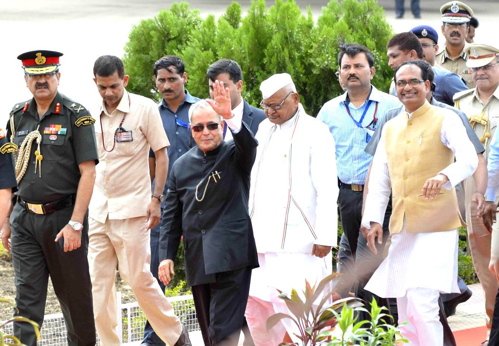 President Pranab Mukherjee arrives at Bhopal Airport on June 27, 2014. Also seen Madhya Pradesh Chief Minister Shivraj Singh Chouhan. - Shivraj Singh Chouhan