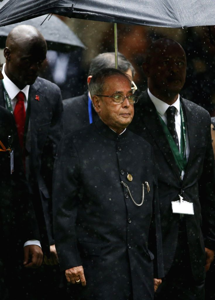 President Pranab Mukherjee arrives at FNB Stadium in Johannesburg to attend a memorial service in honour of South Africa's anti-apartheid icon Nelson Mandela who had been suffering from a ...
