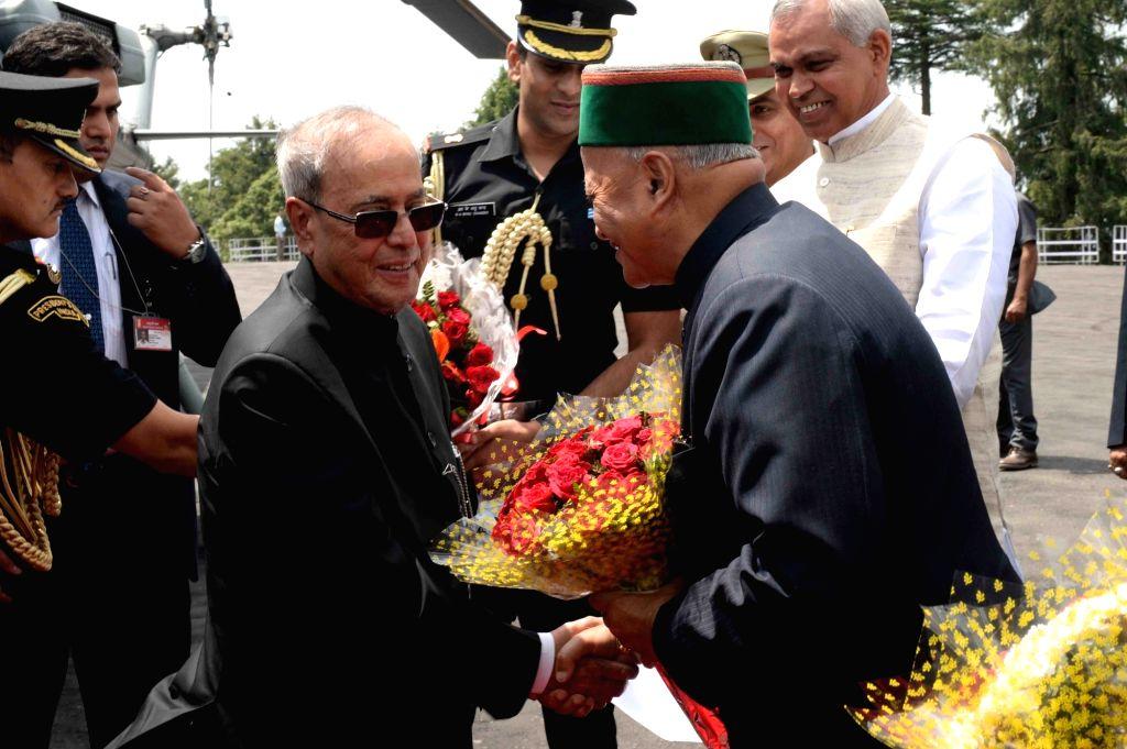 President Pranab Mukherjee being welcomed by Himachal Pradesh Virbhadra Singh on his arrival at Kalyani Helipad in Mashobra of Shimla on June 2, 2016. - Pranab Mukherjee