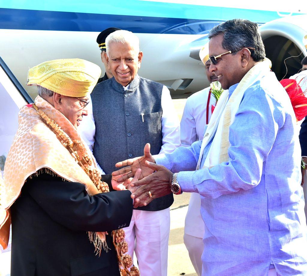 President Pranab Mukherjee being welcomed by Karnataka Governor Vajubhai Rudabhai Vala and Chief Minister Siddaramaiah at the HAL Airport in Bengaluru on June 17, 2017. - Siddaramaiah and Pranab Mukherjee