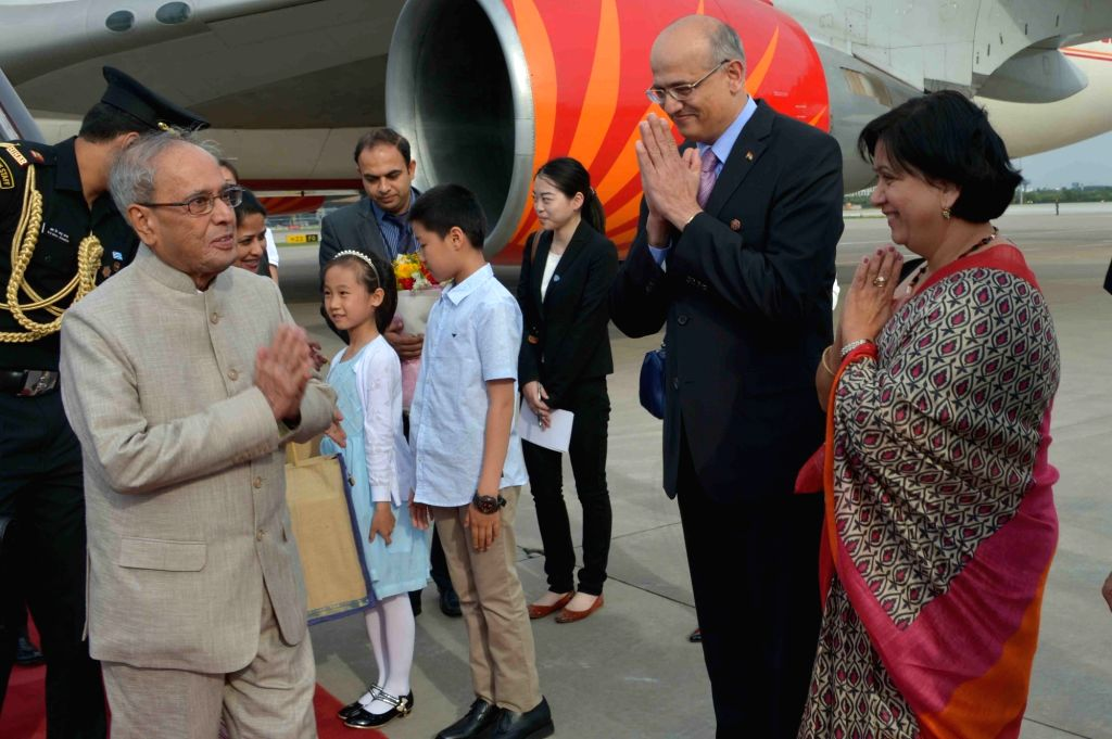 President Pranab Mukherjee being welcomed on their arrival in Beijing on May 25, 2016. - Pranab Mukherjee