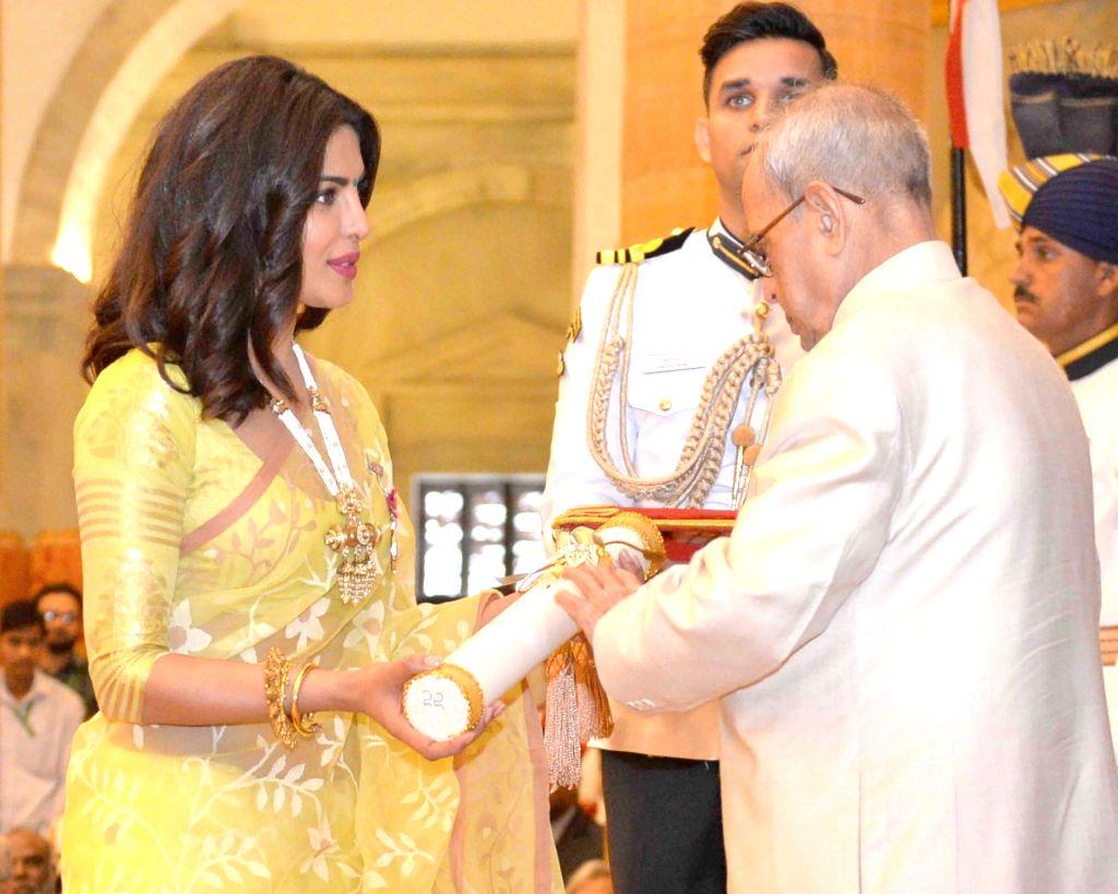President Pranab Mukherjee confers Padma Shri to actress Priyanka Chopra during Civil Investiture Ceremony– II at Rashtrapati Bhawan on April 12, 2016. Also seen Prime Minister Narendra ... - Priyanka Chopra, Narendra Modi and Pranab Mukherjee