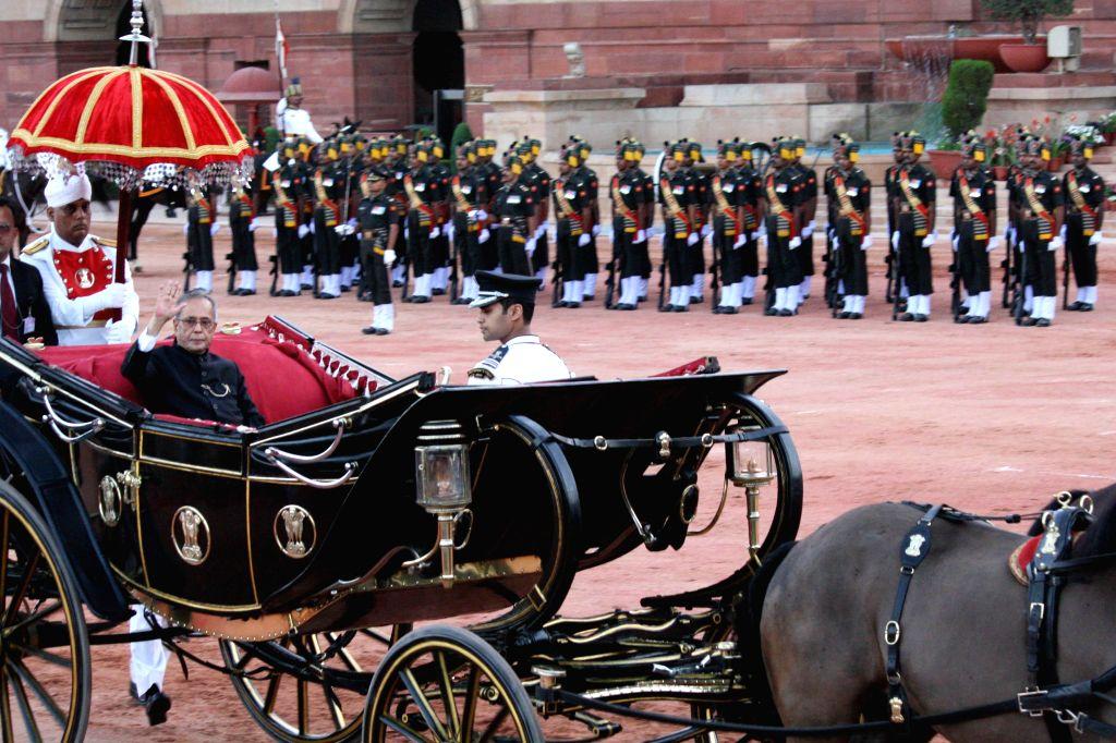 President Pranab Mukherjee during a ceremonial change of guard at Rashtrapati Bhavan in New Delhi on April 9, 2014.
