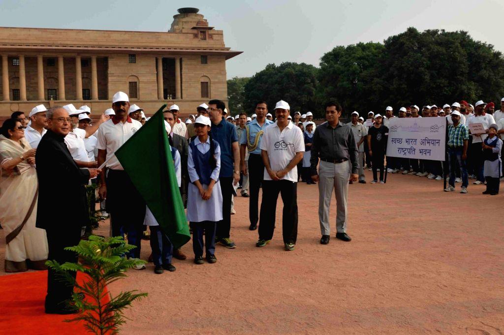 President Pranab Mukherjee during a prgramme organised to flag-off Swachch Bharat Abhiyan March from Rashtrapati Bhavan in New Delhi, on Oct 2, 2016. - Pranab Mukherjee