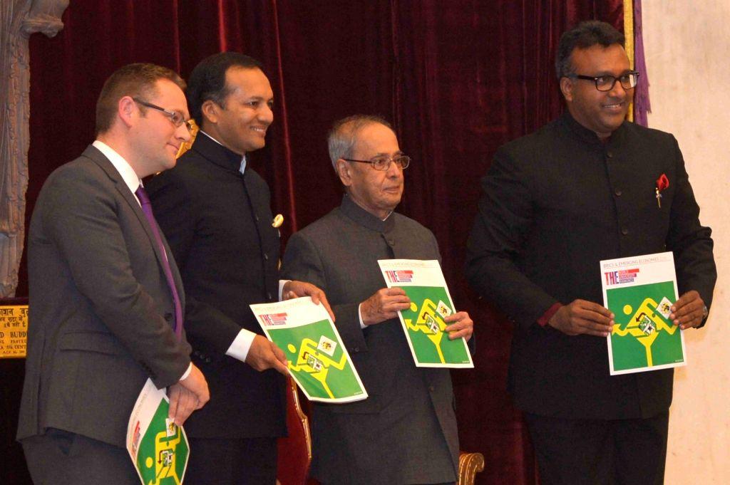 President Pranab Mukherjee during a programme organised to receive the First Copy of the Times Higher Education 'BRICS' & Emerging Economies Universities Rankings, at Rashtrapati ... - Pranab Mukherjee