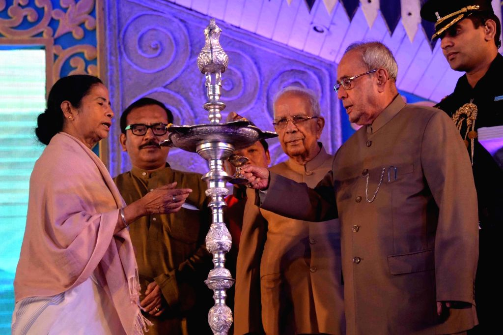 President Pranab Mukherjee during a programme organised to celebrate Bhanubhakta Acharya's birth anniversary in Darjeeling, West Bengal on July 13, 2016. Also seen West Bengal Governor ... - Mamata Banerjee, Pranab Mukherjee and Kesari Nath Tripathi