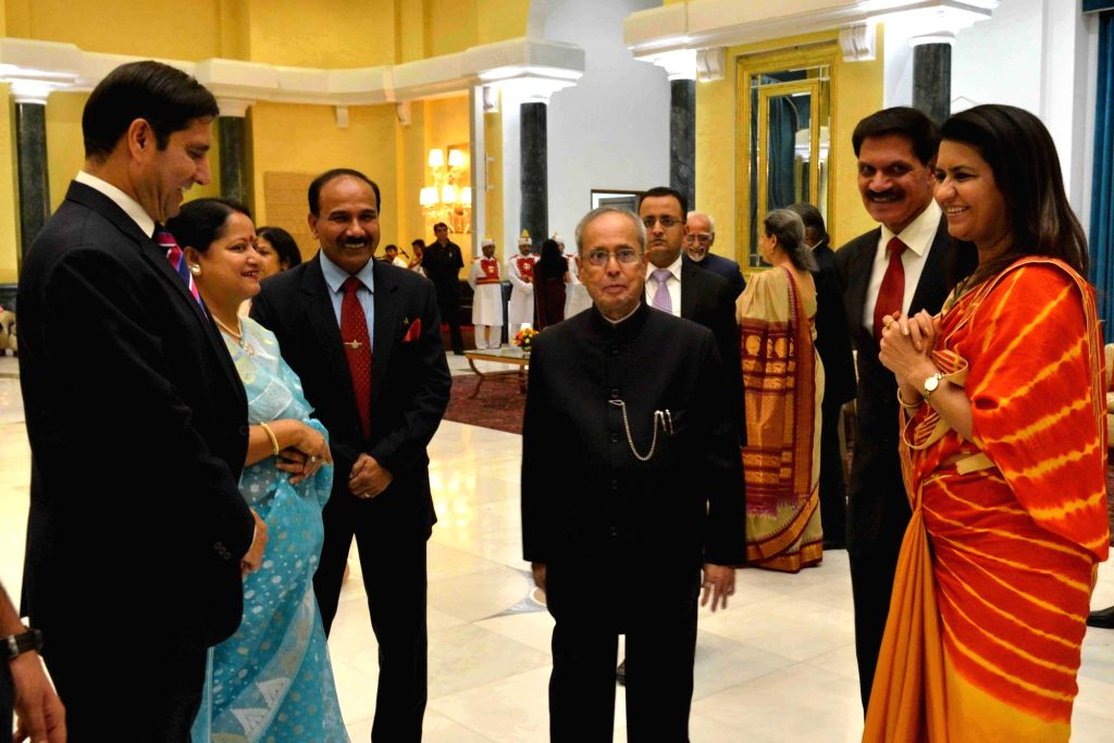 President Pranab Mukherjee during a reception organised on the occasion of Civil Services Day in New Delhi on April 20, 2016. Also seen Chief of Army Staff General Dalbir Singh, Chief of ... - Pranab Mukherjee