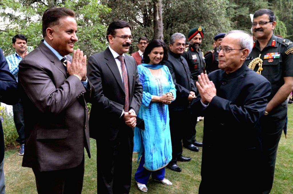 President Pranab Mukherjee during a reception for Himachal Pradesh Ministers and other dignitaries at Mashobra in Shimla on June 5, 2016. - Pranab Mukherjee