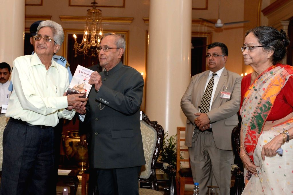 "President Pranab Mukherjee during presentation of books ""Jnan, A-Jnan O Bijnan"" (Knowledge, Non-Knowledge and Science) and ""Samudra Banijjer Prekshite Sthala Banijjya, Bharat ... - Pranab Mukherjee"