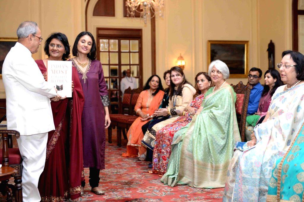 "President Pranab Mukherjee during receiving the Coffee Table Book ""India's Most Powerful Women"" from Young India Associate Editor Prem Ahluwalia at Rashtrapati Bhavan, in New ... - Pranab Mukherjee"