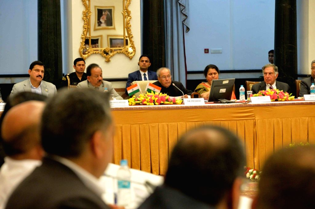 President Pranab Mukherjee during the presentation of key recommendations from the roundtable discussions with leaders on consultation and policy dialogue about start-up, incubation and ... - Ratan Tata and Pranab Mukherjee