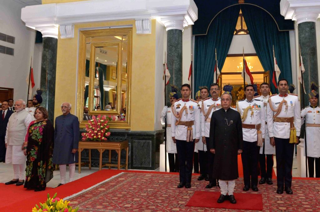 President Pranab Mukherjee during the 'At Home' function organised on the occasion of 70th Independence Day at Rashtrapati Bhavan, in New Delhi on Aug 15, 2016. Also seen Vice President ... - Narendra Modi and Pranab Mukherjee