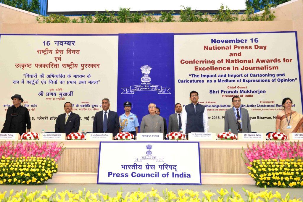 President Pranab Mukherjee during the National Press Day celebrations at Vigyan Bhavan in New Delhi, on Nov 16, 2015. Also seen Minister of State for Information & Broadcasting, Col. ... - Pranab Mukherjee and Rajyavardhan Singh Rathore