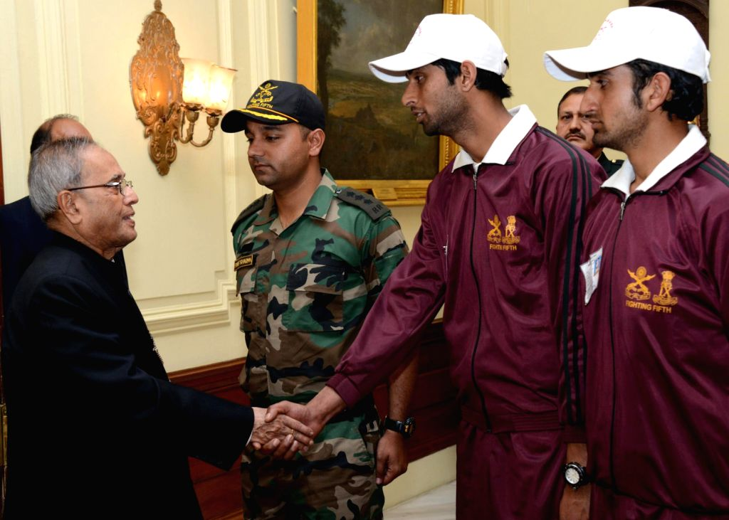 President Pranab Mukherjee interacts with students from Ganderbal district of Jammu and Kashmir at Rashtrapati Bhavan in New Delhi on Dec.13, 2013