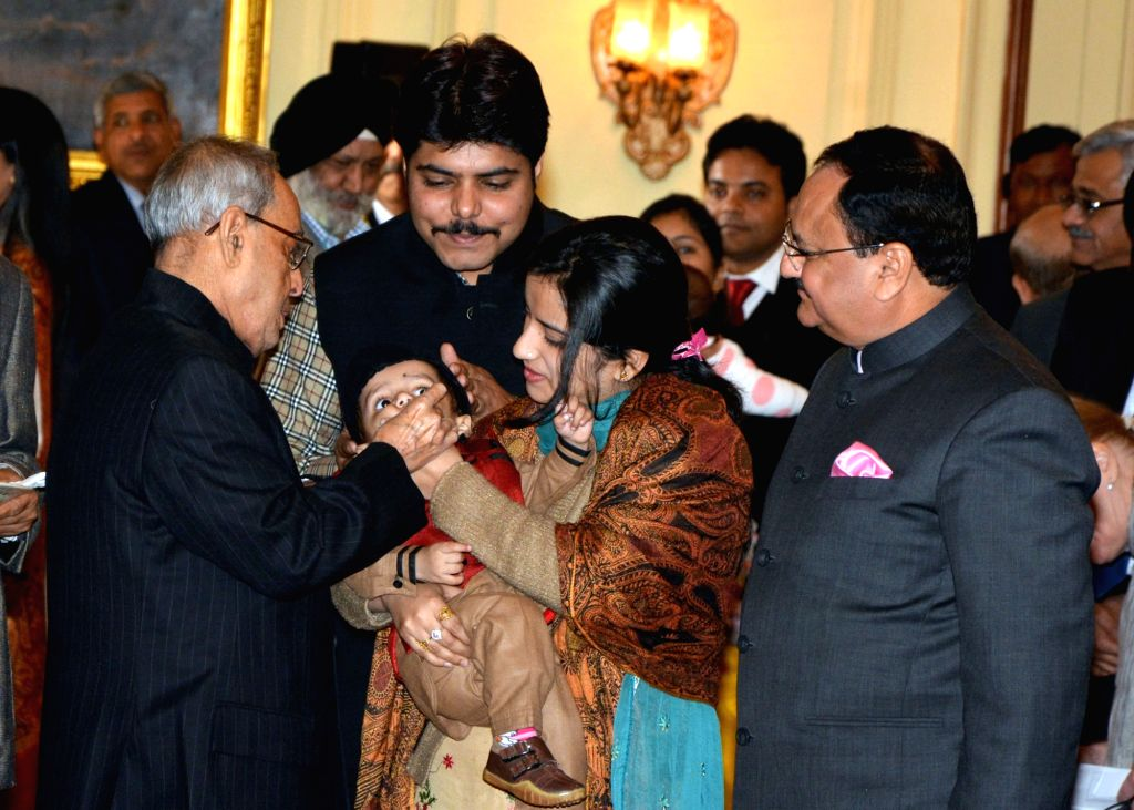 President Pranab Mukherjee launchs the Nationwide Polio Programme by administering Polio Drops to the Children, at Rashtrapati Bhavan, in New Delhi on Jan 16, 2016. Also seen the Union ... - Pranab Mukherjee