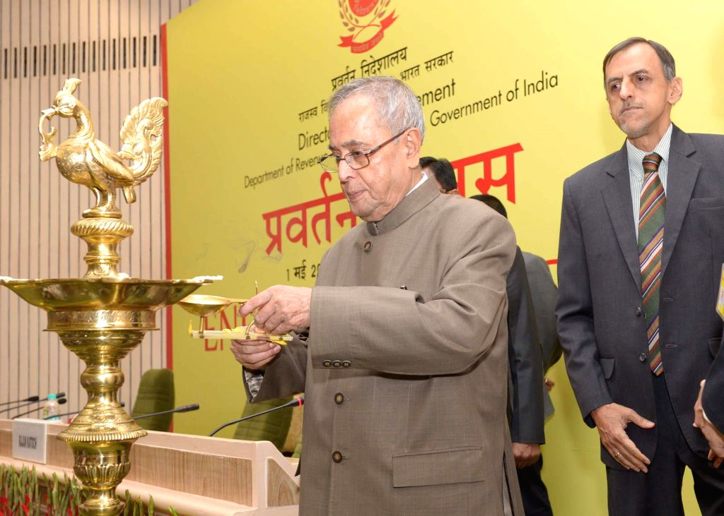 President Pranab Mukherjee lights the inaugural lamp to inaugurate a programme organised on  'Enforcement Day' to celebrate Foundation Day of the Enforcement Directorate at Vigyan Bhavan in New Delhi - Pranab Mukherjee