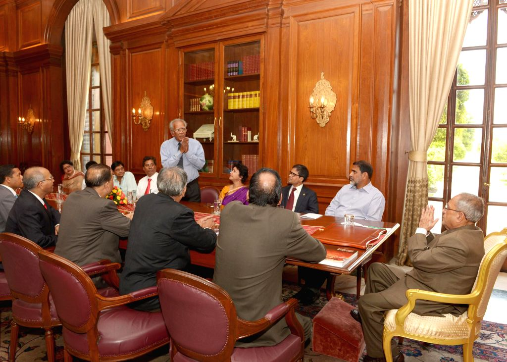 President Pranab Mukherjee meets a delegation of Hindu Buddhist Christian Unity Council (BHBCUC), USA led by Sitangshu Guha at Rashtrapati Bhavan in New Delhi on April 21, 2014.