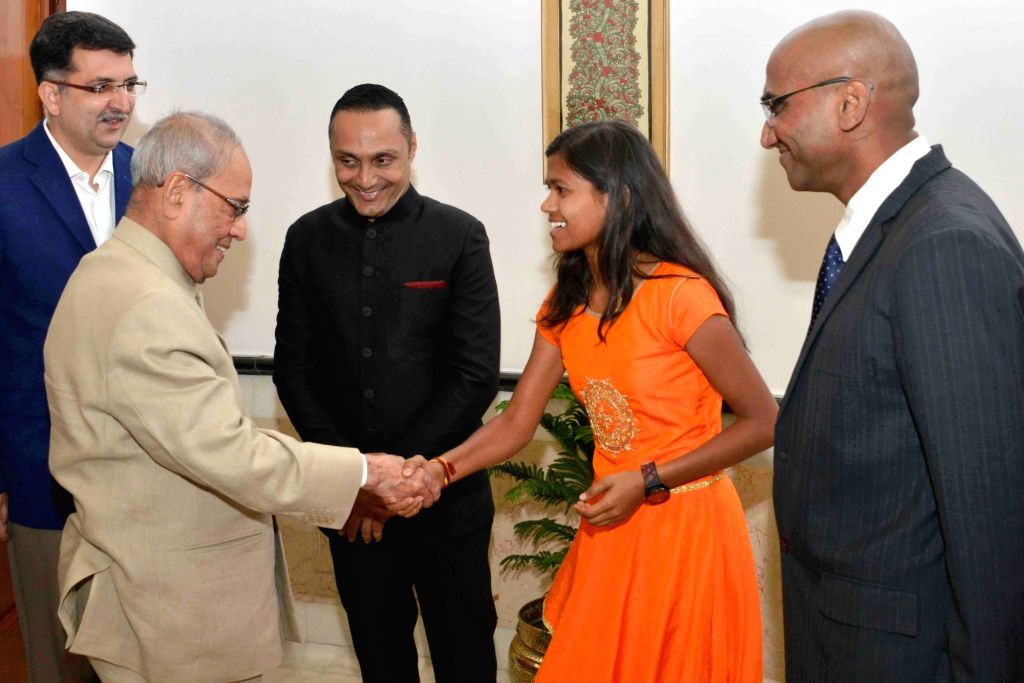 "President Pranab Mukherjee meets actor Rahul Bose and mountaineer Poorna Malavath during special screening of film ""Poorna"" at Rashtrapati Bhavan Auditorium on March 25, 2017. - Rahul Bose and Pranab Mukherjee"