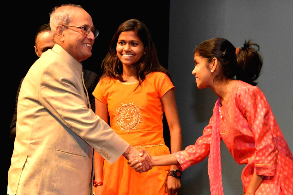 "President Pranab Mukherjee meets mountaineer Poorna Malavath and actress Aditi Inamdar during special screening of film ""Poorna"" at Rashtrapati Bhavan Auditorium on March 25, ... - Aditi Inamdar and Pranab Mukherjee"