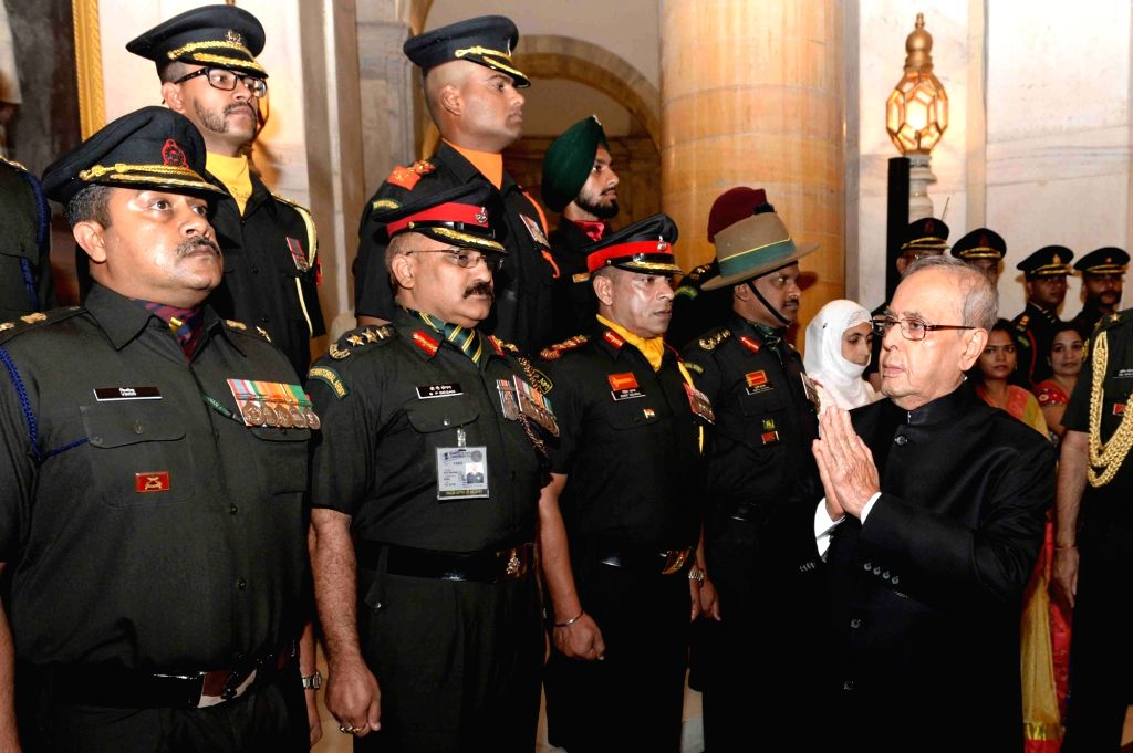 President Pranab Mukherjee meets Territorial Army Officers and their spouses on Raising Day of Territorial Army at Rashtrapati Bhavan on Oct 6, 2016. - Pranab Mukherjee