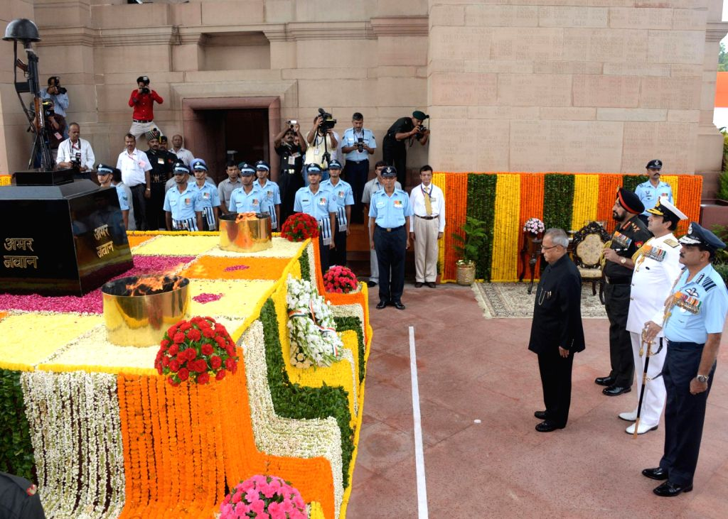 President Pranab Mukherjee, paying tributes at Amar Jawan Jyoti at India Gate on the occasion of the 67th Independence Day, in Delhi on August 15, 2013. (Photo::: IANS)