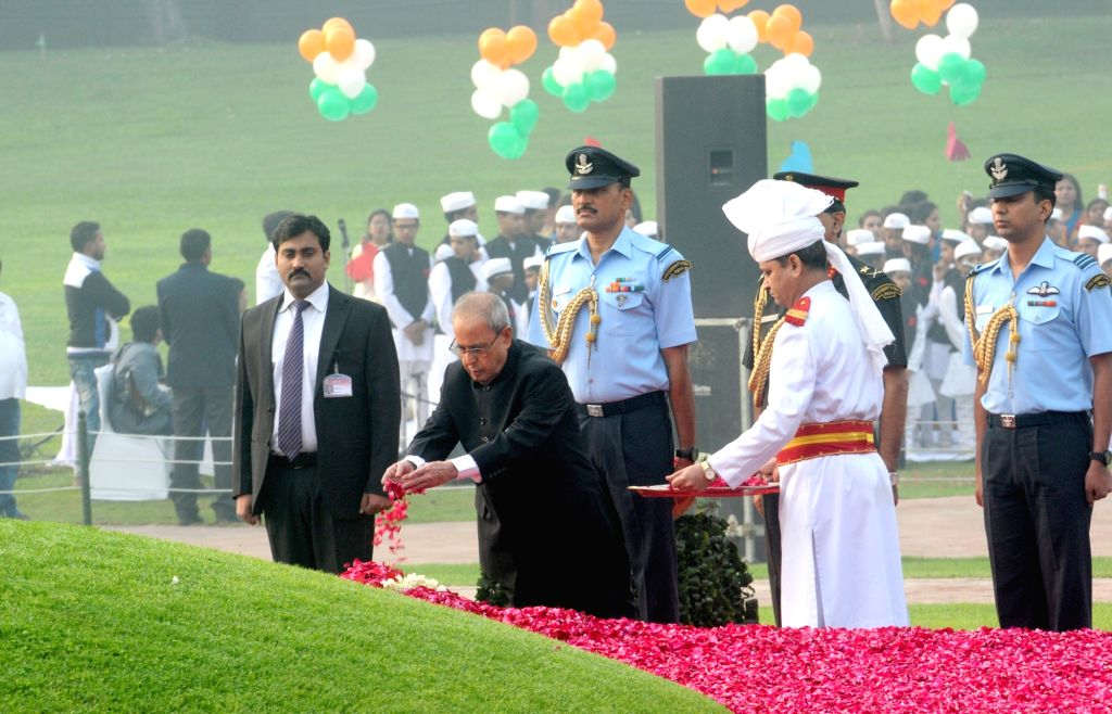 President Pranab Mukherjee pays floral tribute at the Samadhi of the former Prime Minister Pandit Jawaharlal Nehru on his 126th birth anniversary, at Shantivan, in New Delhi on Nov 14, ... - Pandit Jawaharlal Nehru and Pranab Mukherjee