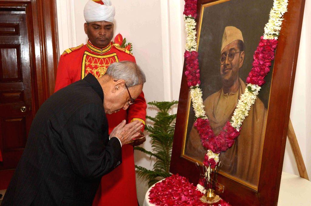 President Pranab Mukherjee pays floral tribute at the portrait of Netaji Subhash Chandra Bose on the occasion of his birth anniversary at Rashtrapati Bhavan in New Delhi, on Jan 23, 2016. - Pranab Mukherjee