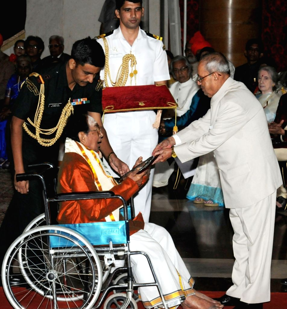 President Pranab Mukherjee presents Sangeet Natak Akademi Award-2015 to T.N. Sankaranthan, in the field of Puppetry, at the investiture ceremony of the Sangeet Natak Akademi Fellowships ... - Pranab Mukherjee