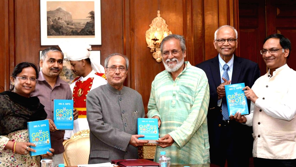 President Pranab Mukherjee receive a copy of the book 'Grassroots Innovations' from National Innovation Foundation-India (Ahmedabad) Executive Vice Chairperson Prof. Anil K. Gupta at ... - Pranab Mukherjee and K. Gupta