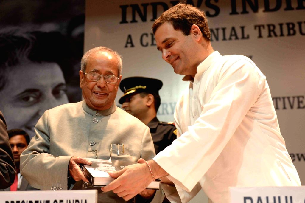 "President Pranab Mukherjee receives the first copy of the book ""India's Indira : A Centennial Tribute"" from Congress vice-president Rahul Gandhi during a programme in New Delhi ... - Pranab Mukherjee and Rahul Gandhi"
