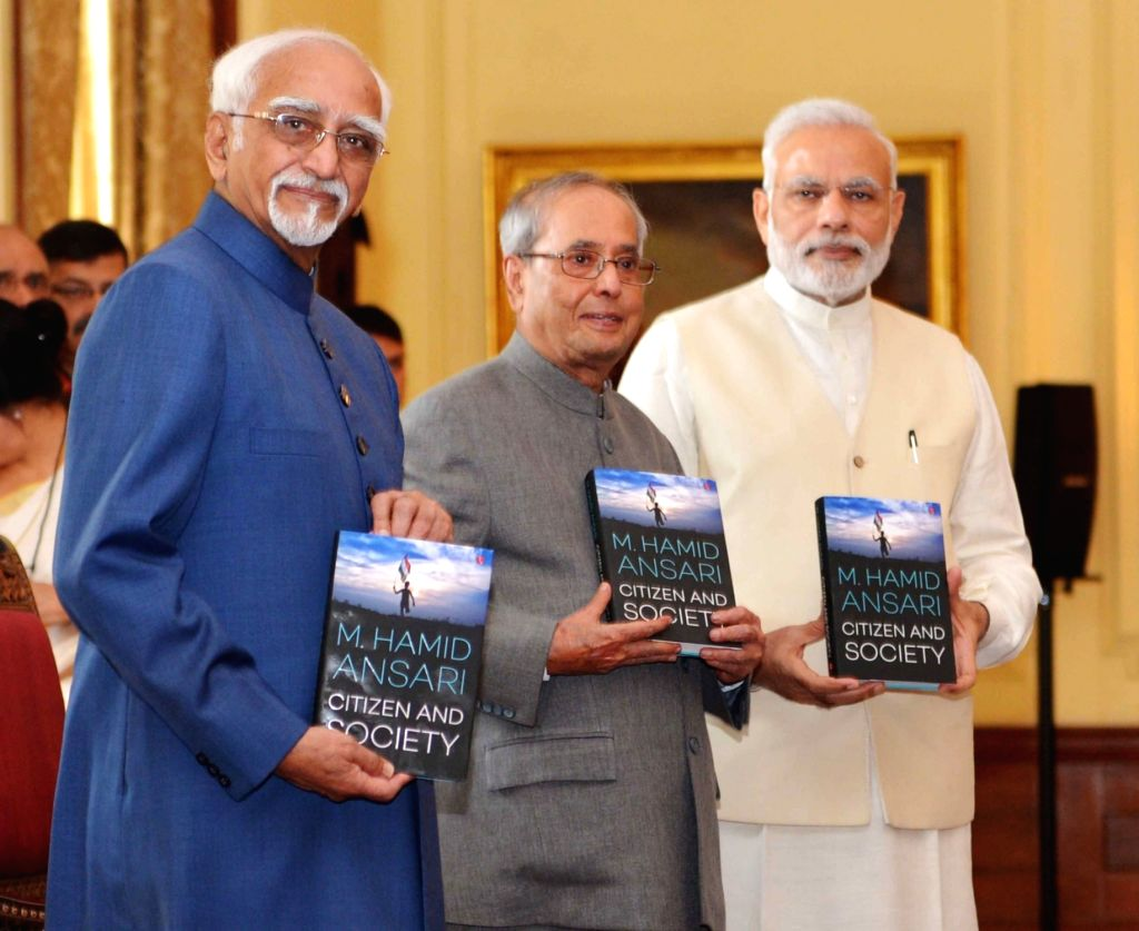President Pranab Mukherjee release the book 'Citizen and Society' authored by the Vice President M Hamid Ansari at Rashtrapati Bhavan in New Delhi on Sept 23, 2016. Also seen Prime ... - Narendra Modi and Pranab Mukherjee