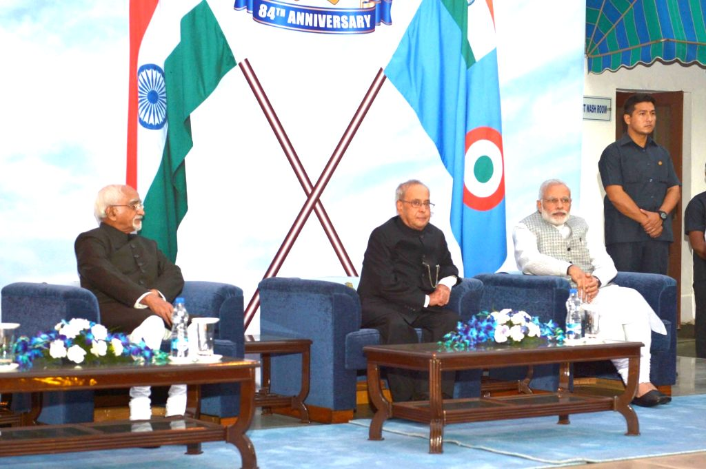 "President Pranab Mukherjee, the Vice President M Hamid Ansari and Prime Minister Narendra Modi at the ""At Home"" programme hosted by the Chief of the Air Staff, Air Chief Marshal ... - Narendra Modi and Pranab Mukherjee"