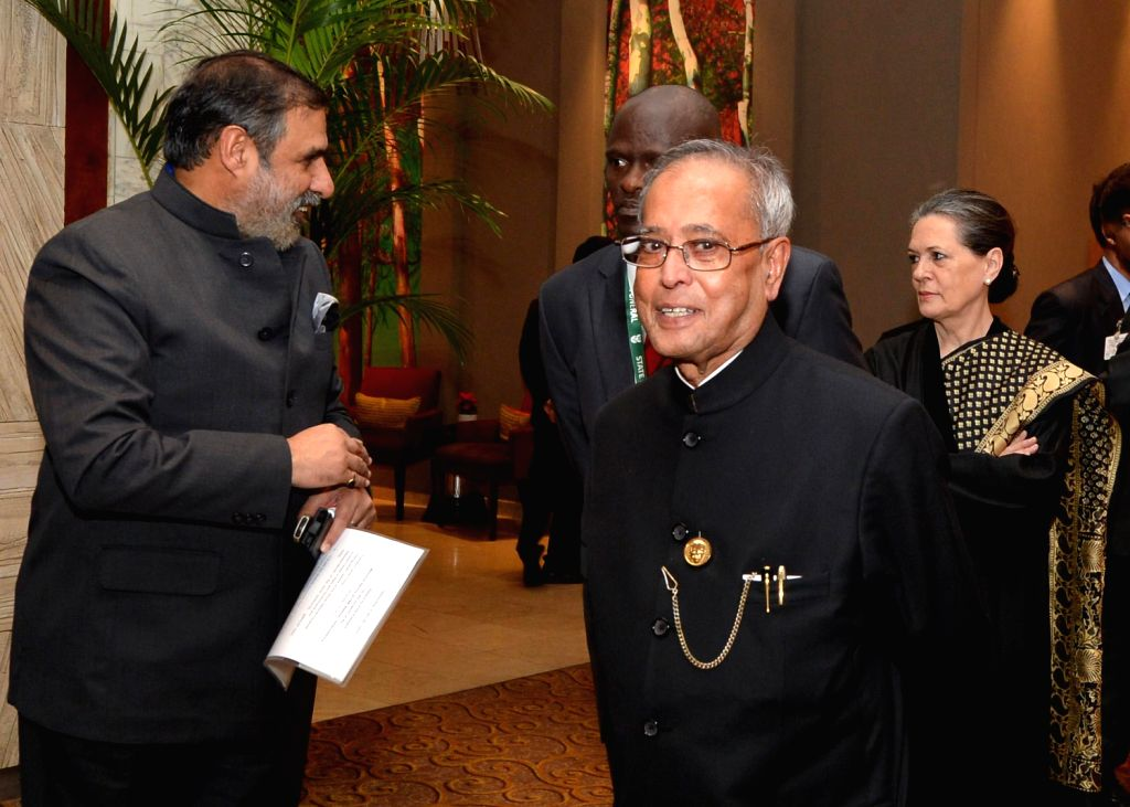President Pranab Mukherjee, Union Commerce Minister Anand Sharma and UPA Chairperson Sonia Gandhi before departing for FNB Stadium to attend a memorial service in honour of South Africa's ... - Anand Sharma and Sonia Gandhi