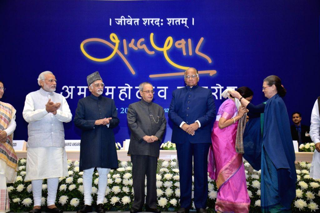 President Pranab Mukherjee, Vice-President Mohammad Hamid Ansari, Prime Minister Narendra Modi, Congress president Sonia Gandhi during the 75th birthday celebrations of Sharad Pawar in New ... - Narendra Modi, Pranab Mukherjee and Sonia Gandhi