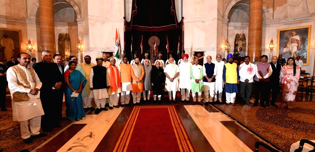 President Pranab Mukherjee, Vice-President Mohammad Hamid Ansari and Prime Minister Narendra Modi with Union Minister Prakash Javadekar and other newly appointed union ministers at a ... - Narendra Modi and Pranab Mukherjee
