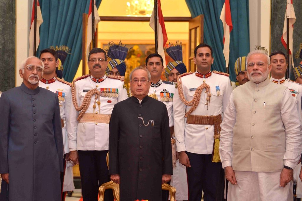President Pranab Mukherjee, Vice President Mohammad Hamid Ansari and Prime Minister Narendra Modi during the 'At Home' function organised on the occasion of 70th Independence Day at ... - Narendra Modi and Pranab Mukherjee