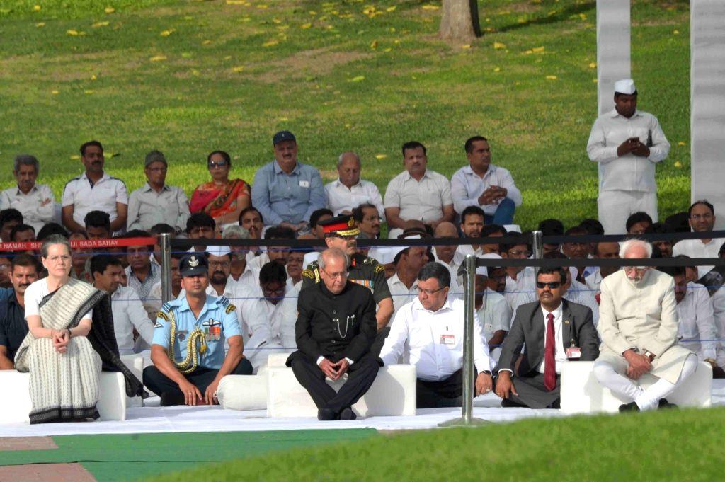 President Pranab Mukherjee, Vice President M. Hamid Ansari  and Congress president Sonia Ghandhi on occasion of 53rd death anniversary  of  Pandit Jawaharlal Nehruat Shanti Van in Delhi on ... - Pranab Mukherjee