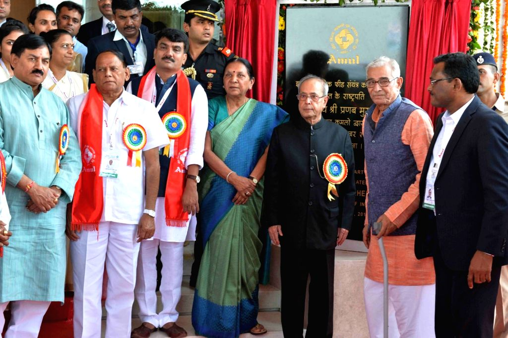 President Pranab Mukherjee visits after inaugurating the Amul's State-of-the-art Feed Manufacturing Plant, at Kapadwanj Tuluka, Kheda in Gujarat. Also seen the Gujarat Governor O P Kohli and ... - Anandiben Patel, Pranab Mukherjee and O P Kohli