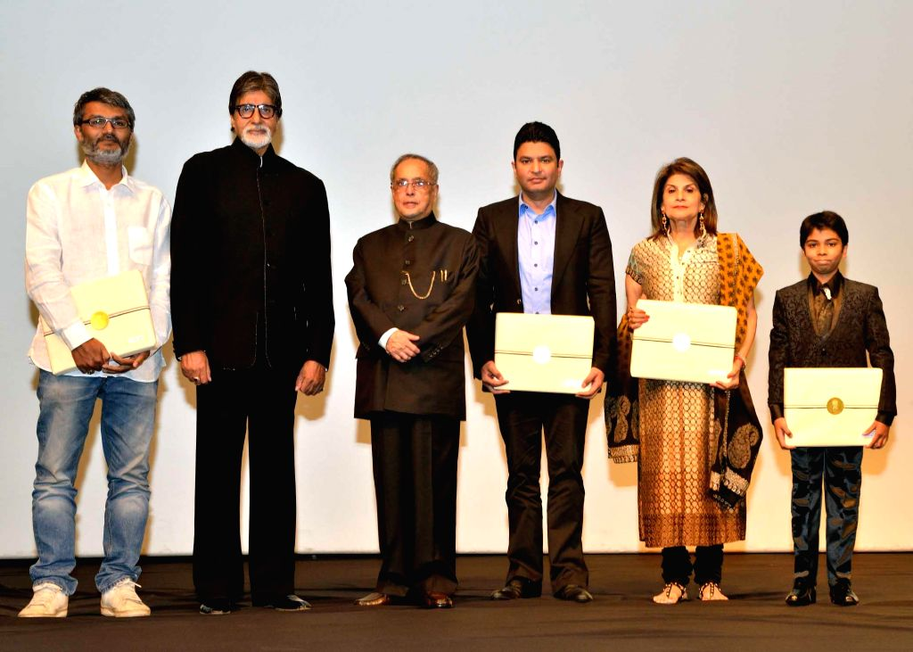 President Pranab Mukherjee with actor Amitabh Bachchan and other actors of 'Bhootnath Returns', during a special screening of the film at Rashtrpati Bhavan Auditorium in New Delhi on April 17, 2014. - Amitabh Bachchan and Pranab Mukherjee