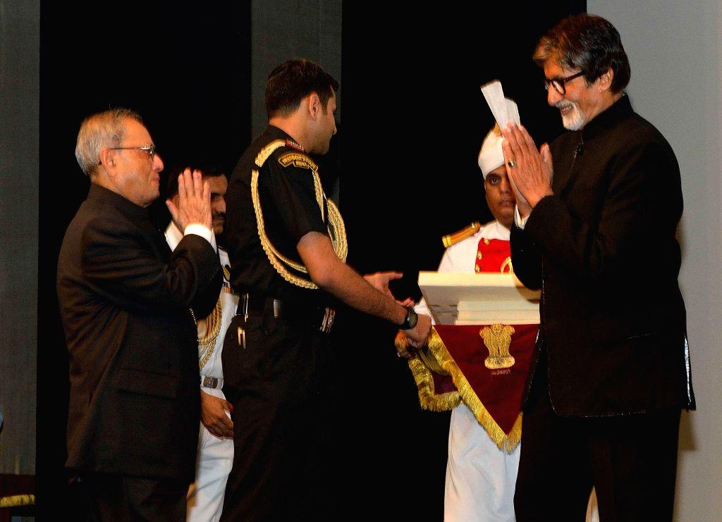 President Pranab Mukherjee with actor Amitabh Bachchan during a special screening of his film 'Bhootnath Returns' at Rashtrpati Bhavan Auditorium in New Delhi on April 17, 2014. - Amitabh Bachchan and Pranab Mukherjee