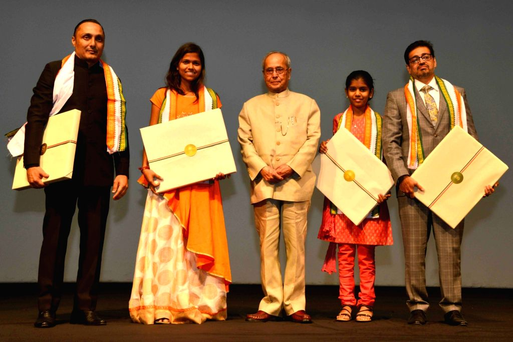 "President Pranab Mukherjee with actor Rahul Bose, mountaineer Poorna Malavath and actress Aditi Inamdar during special screening of film ""Poorna"" at Rashtrapati Bhavan Auditorium ... - Rahul Bose and Pranab Mukherjee"