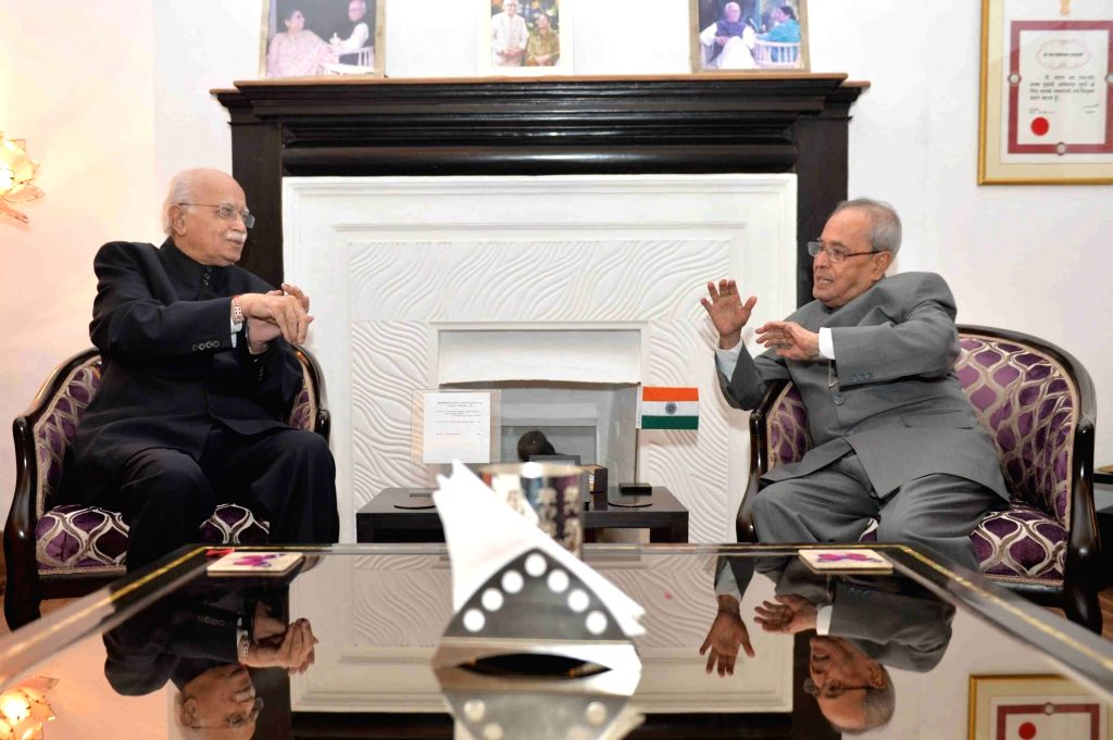 President Pranab Mukherjee with BJP veteran L K Advani during a programme organised to celebrate the latter's birthday in New Delhi, on Nov 27, 2015. - Pranab Mukherjee