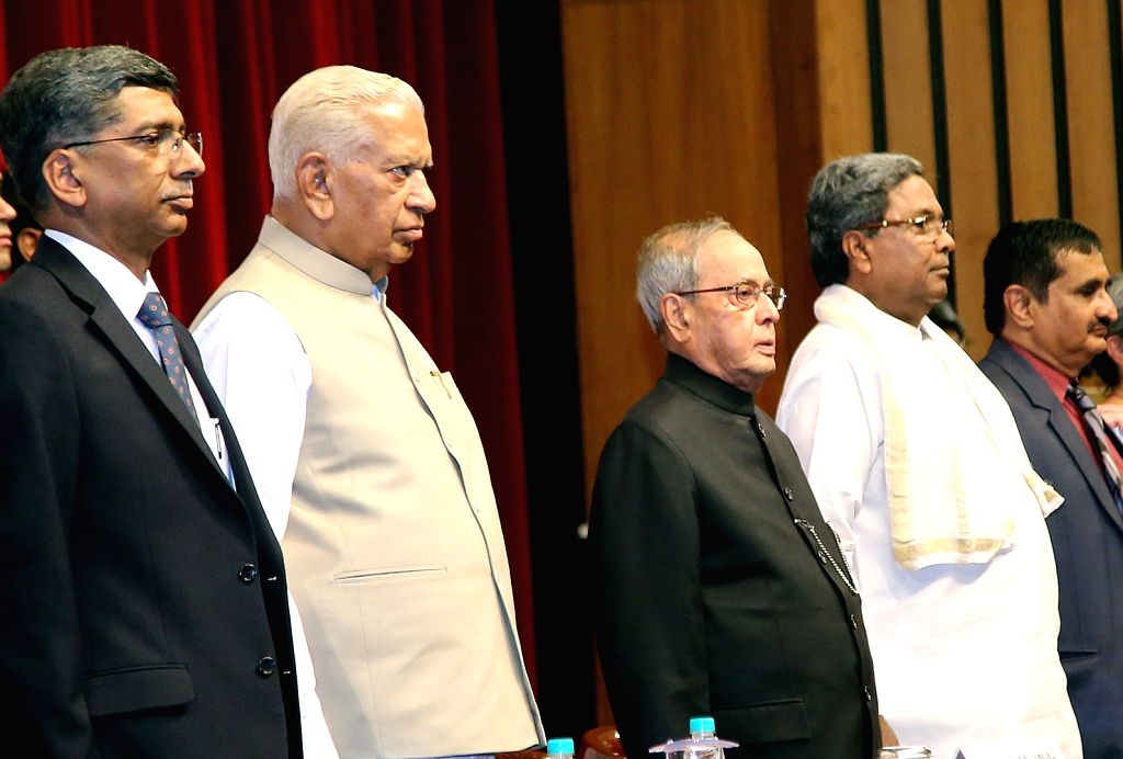 President Pranab Mukherjee with Karnataka Governor Vajubhai Rudabhai Vala and Chief Minister Siddaramaiah during the annual convocation of Indian Institute of Science (IISc) in Bengaluru ... - Siddaramaiah and Pranab Mukherjee