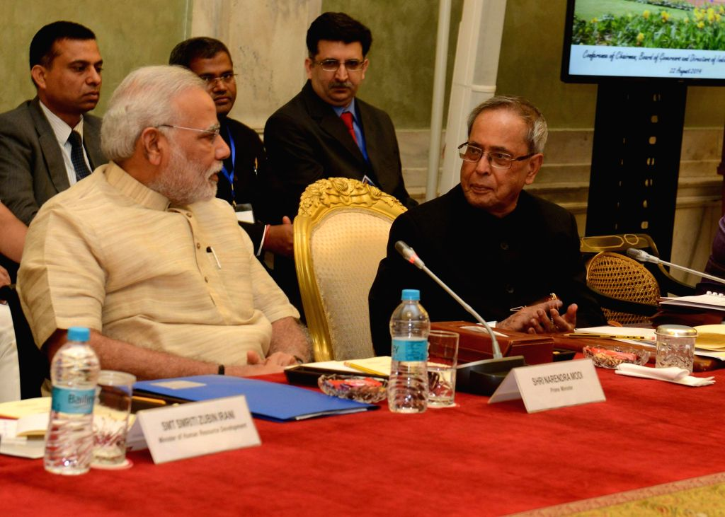 President Pranab Mukherjee with Prime Minister Narendra Modi during `Conference of Chairman, Board of Governors and Directors of Indian Institute of Technology` at Rashtrapati Bhavan in New Delhi on . - Narendra Modi and Pranab Mukherjee