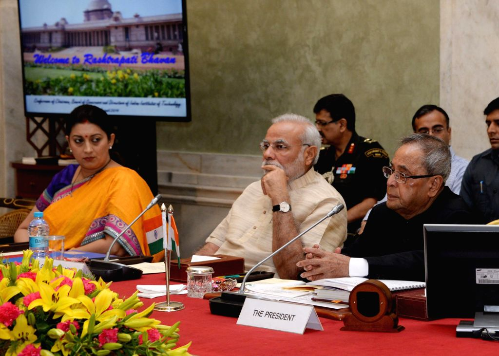 President Pranab Mukherjee with Prime Minister Narendra Modi and Union HRD Minister Smriti Z Irani  during `Conference of Chairman, Board of Governors and Directors of Indian Institute of Technology` - Narendra Modi, Pranab Mukherjee and Smriti Z Irani