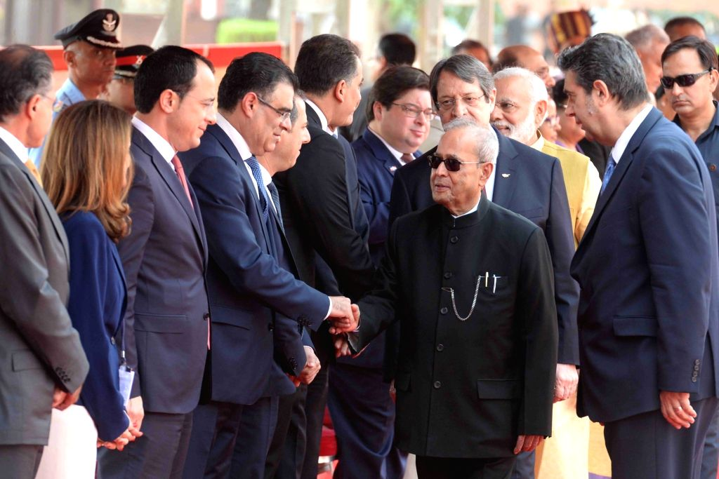 President Pranab Mukherjee with Prime Minister Narendra Modi receives Nicos Anastasiades, President of the Republic of Cyprus during his ceremonial reception at forecourt in Rashtrapati ... - Narendra Modi and Pranab Mukherjee
