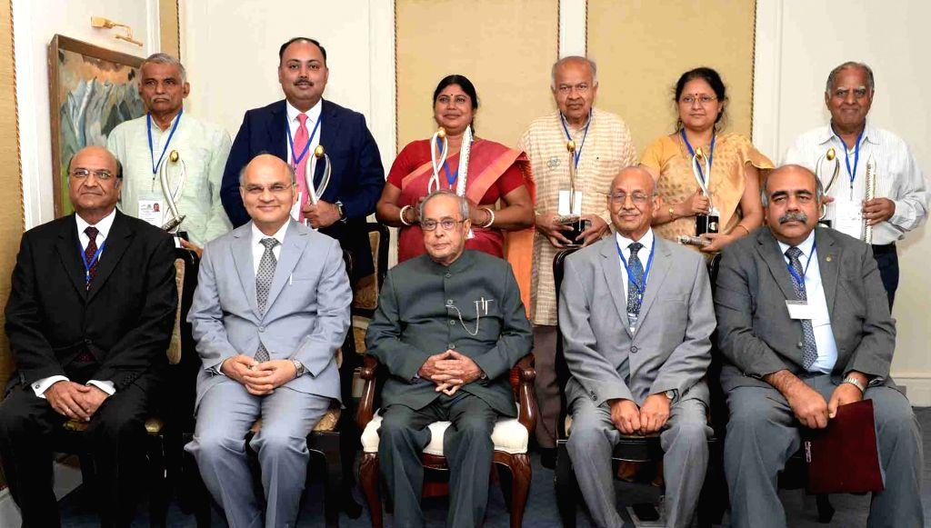 President Pranab Mukherjee with the recipients of the Lakshmipat Singhania - IIM Lucknow National ership Awards in New Delhi on June 27, 2017. - Pranab Mukherjee