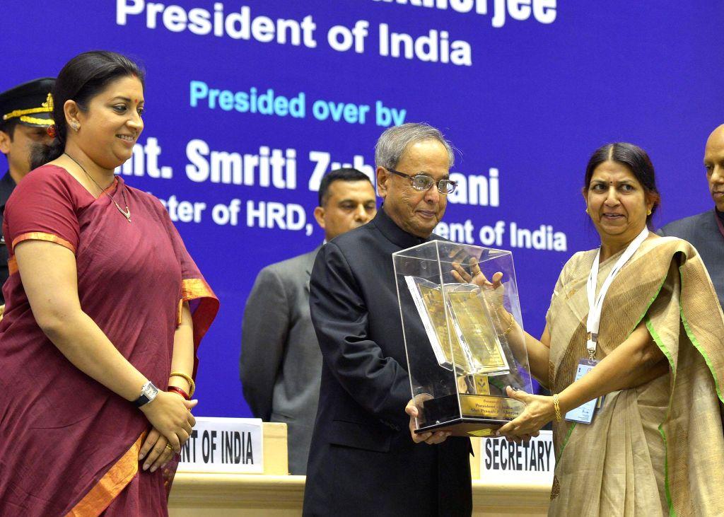 President Pranab Mukherjee with Union HRD Minister Smriti Irani during the International Literacy Day celebrations at Vigyan Bhawan in New Delhi on Sept 8, 2014. - Smriti Irani and Pranab Mukherjee