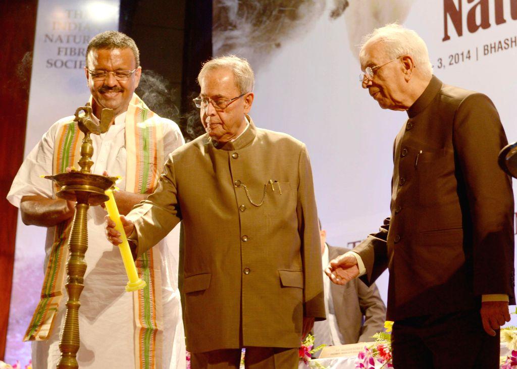 President Pranab Mukherjee with West Bengal Governor Keshari Nath Tripathi during inauguration of International Conference on Natural Fibres in Kolkata on August 1, 2014. - Pranab Mukherjee and Keshari Nath Tripathi